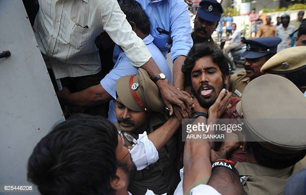 TOPSHOT Indian police detain a member of the Communist Party of India outside a bank during a protest against Indian Prime Minister Narendra Modi and...