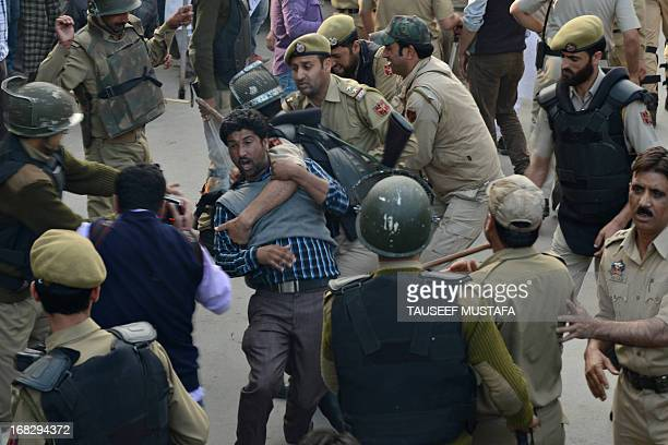 Indian police detain a Public Health Engineering department government employee during a protest in Srinagar on May 8 2013 Indian police detained...