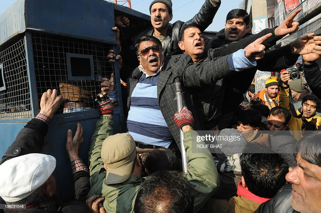 Indian police detain Kashmiri state government employees during a protest march in Srinagar on January 10, 2013. Dozens of government employees were arrested as they tried to stage a protest march in Srinagar. Local government employees began a three-day strike January 8 to build pressure on the region's government to take decision on their pending demands which include improvements on contractors wages and retirement benefits. AFP PHOTO/Rouf BHAT