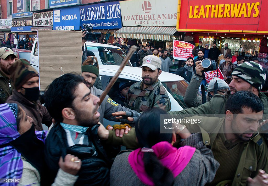 Indian police detain Trainers (Preraks) employed under Sakshar Bharat Mission, a scheme sponsored by Indian government shout slogans during a protest against the government for not paying their salaries on December 30, 2013 in Srinagar, the summer capital of Indian administered Kashmir, India. Dozens of Preraks employed under the scheme, sponsored by the Indian government, were injured after Indian police attempted to disperse the crowd using batons. The group was protesting against the Government for non-payment of their honorarium, due for the last two years.