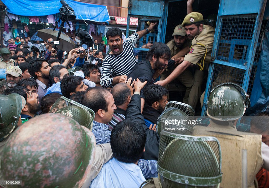 Indian police detain <a gi-track='captionPersonalityLinkClicked' href=/galleries/search?phrase=Yasin+Malik&family=editorial&specificpeople=691200 ng-click='$event.stopPropagation()'>Yasin Malik</a> leader of Jammu and Kashmir Liberation Front (JKLF) a separatist party fighting politically against India and Pakistan for complete Independence of Kashmir, during a protest against the recent Shopian killings on September 13, 2013 in Srinagar, the summer capital of Indian administered Kashmir, India. Indian government forces have reimposed a curfew in Shopian following the death of a Kashmir Muslim youth who was shot by Indian military forces on September 11. The death toll in the area that has risen to five since last Saturday.