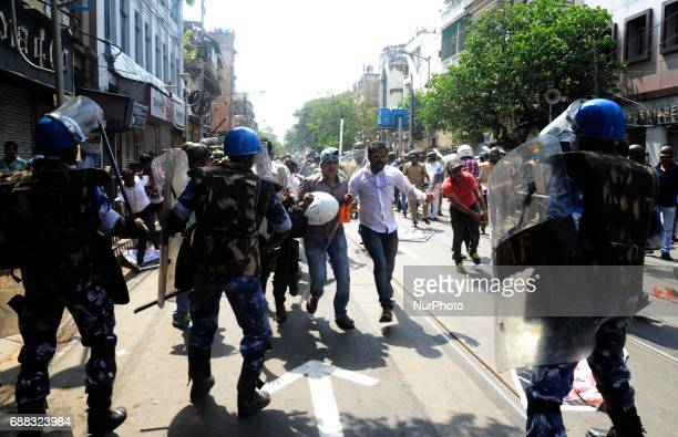 Indian police disperse the Bharatiya Janata Party activists during their march to the police headquarters in Kolkata India on Thursday 25th...