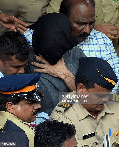 Indian police escort the exhusband of former media executive Indrani Mukherjea Sanjeev Khanna from a city court in Mumbai on August 31 2015 A former...