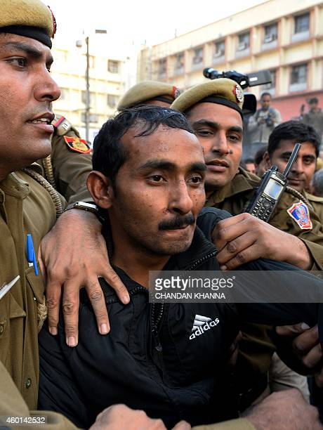 Indian police escort Uber taxi driver and accused rapist Shiv Kumar Yadav following his court appearance in New Delhi on December 8 2014 Delhi's...