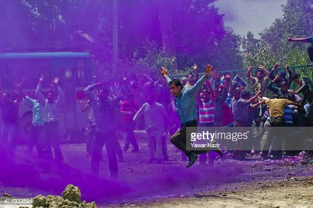 Indian police fire a jet of cannons of purple dyed chemical water at Kashmiri daily wage employees during a protest against the government on May 28...