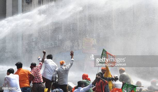 Indian police fire a water cannon at activists of the Bhartiya Janata Party next to the state police headquarters in Kolkata on May 25 2017 The...