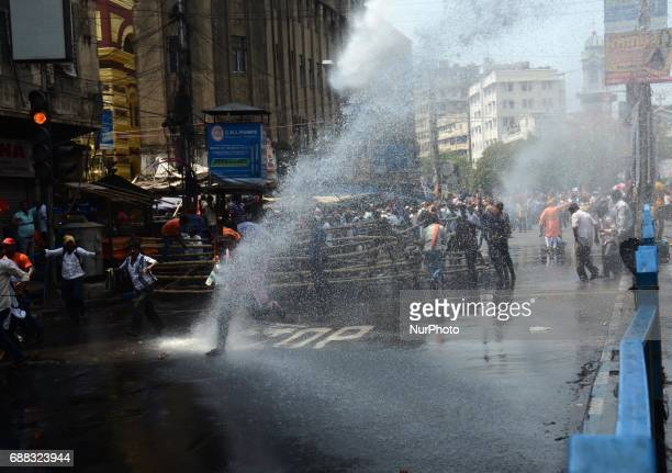 Indian police fire water cannons to disperse the Bharatiya Janata Party activists during their march to the police headquarters in Kolkata India on...