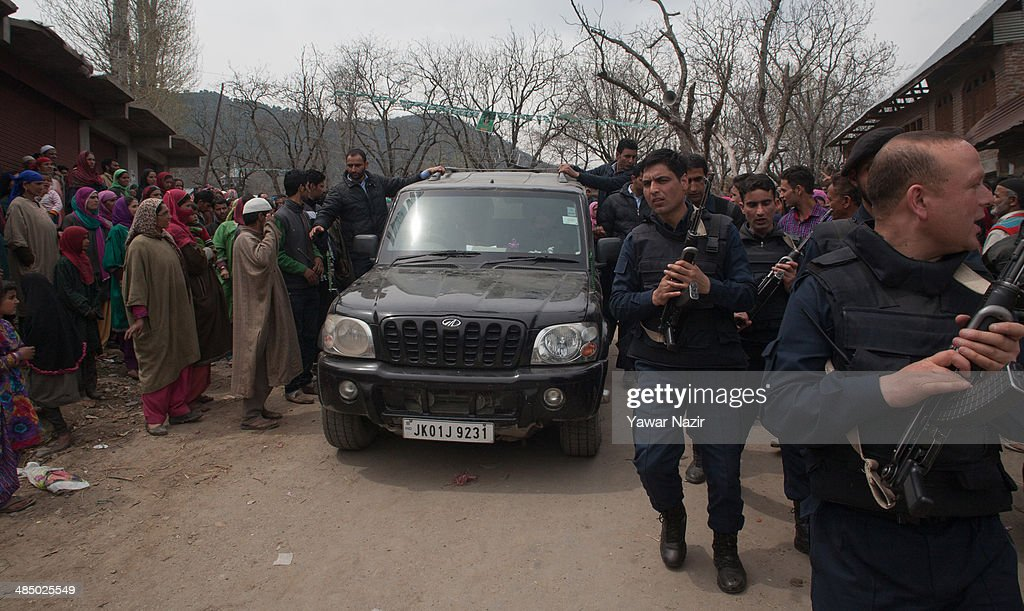Indian police guard the vehicle of Kashmir's main opposition political party, Peoples Democratic Party's (PDP) leader Mehbooba Mufti, and candidate for South Kashmir during her road show on April 15, 2014, in Tsimer about 90 km south of Srinagar, the summer capital of Indian administered Kashmir, India.Kashmir's main opposition political party, Peoples Democratic Party's (PDP) leader Mehbooba Mufti, and candidate for South Kashmir started off with road shows across 21 villages as a part of her election campaign for the upcoming Lok Sabha polls on Tuesday. She started from Pahloo of the Noorabad constituency.