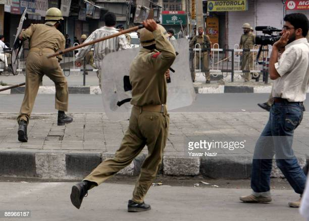 Indian police move in on journalists and civilians during a protest on July 10 2009 in Srinagar in the Indian Administered Kashmir The police...