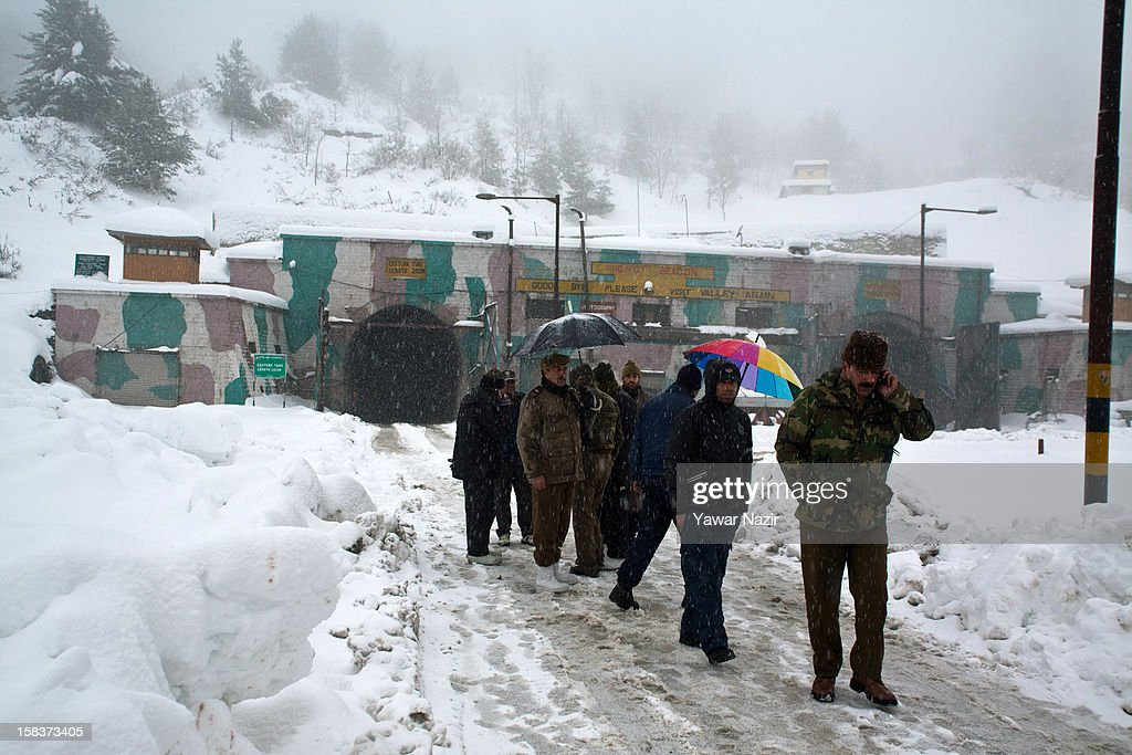 Indian police officers inspects the condition of highway, stranded vehicles and passengers near Jahar Tunnel on December 14, 2012 in Banihal, 110 km (68 miles) south of Srinagar, the summer capital of Indian Administered Kashmir, India. Most parts of the Kashmir Valley, including Srinagar, received fresh snowfall, leading to closure of the 300 km (188 miles) Jammu-Srinagar Highway, the only road link between Kashmir and rest of India. Project Beacon authorities of the Border Roads Organisation, that maintains the highway, had already started efforts to clear the highway for traffic. The number of vehicles stranded on the highway was being ascertained.
