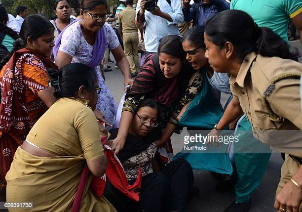 Indian police officials detain the activist of Socialist Unity Center of IndiaMarxist during the protest against child trafficking in West Bengal in...