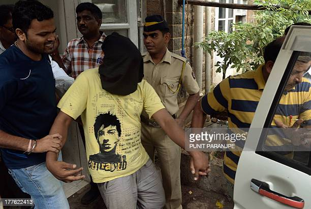 Indian police officials escort a suspect in the gangrape of a female photographer after his appearance at a court in Mumbai on August 25 2013 Mumbai...