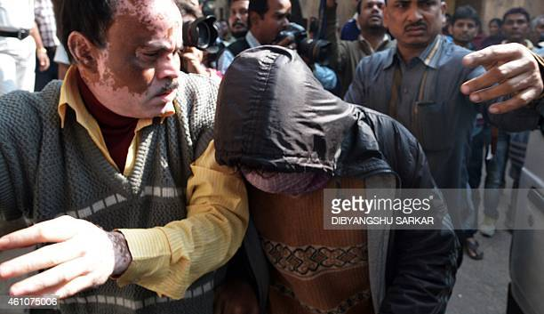 Indian police officials escort acccused Sajid Khan to the Bankshall court in Kolkata on January 6 2015 Police in India's eastern city of Kolkata have...