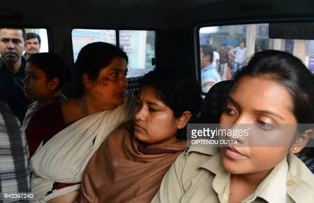 Indian police officials escort Chandana Chakraborty and Sonali Mondal from a police station in Jalpaiguri on February 21 for a medical check up to a...