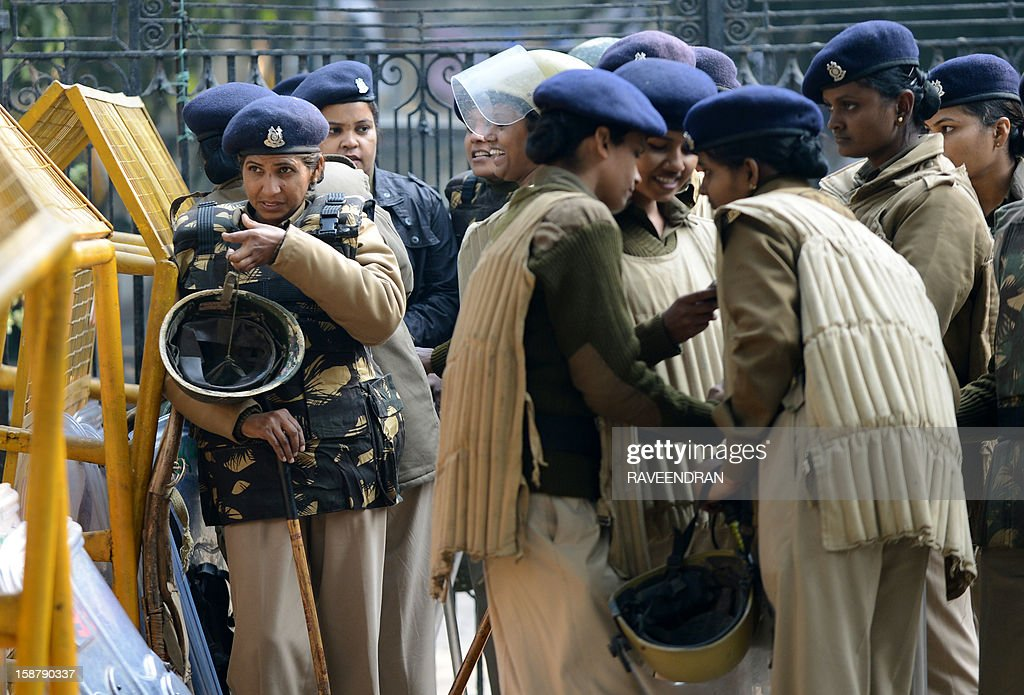 Indian police officials gather beside barriers on a street in New Delhi on December 29, 2012, as Indian leaders appealled for calm fearing fresh outbursts of protests after the death of a gang-rape victim. New Delhi's top police officer and chief minister have urged people to mourn the death of a gang-rape victim in a peaceful manner as large parts of the city-centre were sealed off. The calls for calm came after an Indian woman who was gang-raped on a New Delhi bus died in a Singapore hospital after suffering severe organ failure.
