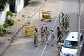 Indian police officials gather in a cordoned off area of a street in Bangalore on December 29 following an explosion in the southern Indian city late...