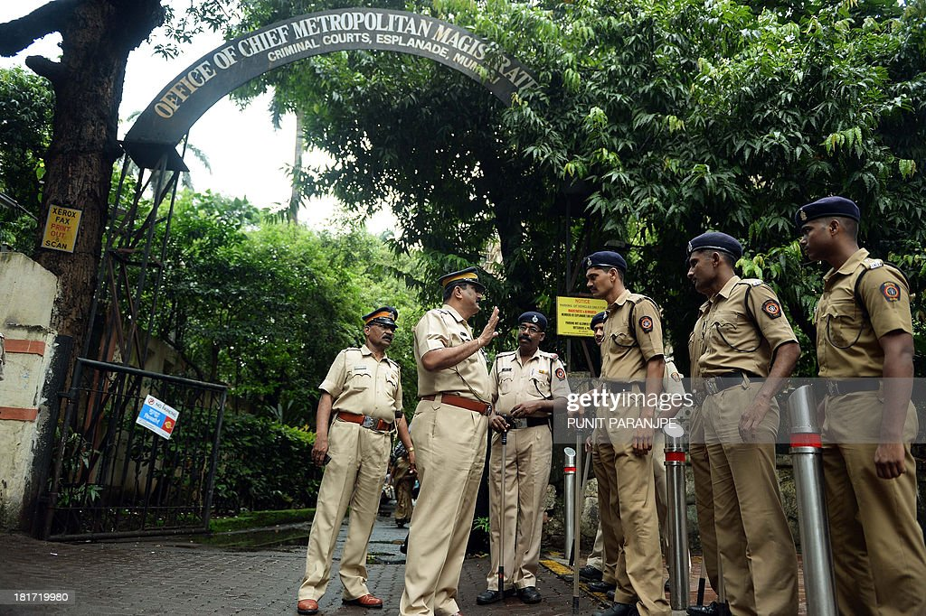 Indian police officials hold a briefing ahead of the arrival of Pakistani judicial commission members at a court in Mumbai on September 24, 2013. A seven-member Pakistan judicial commission will cross examine witnesses in the 2008 Mumbai terror attack case.