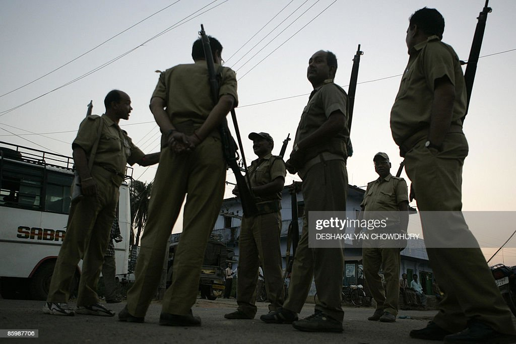 Indian police officials stand guard outside an election control room in Satgawan some 200kms north of Ranchi on April 15 on the eve of the first...