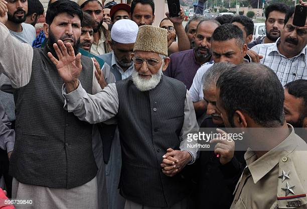 Indian police personals detain senior separatist leader of the All Parties Hurriyat Conference Syed Ali Shah Geelani outside his house as he tried to...