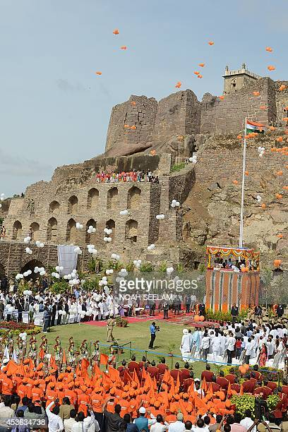 Indian police personnel and government officials from the recently formed southern Telangana state attend the flag hoisting during celebrations of...