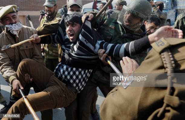 Indian police personnel detain a Kashmiri Shiite Muslim during a clash in Srinagar on November 13 as Shiite Muslim residents defy restrictions over...