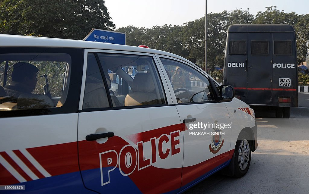 Indian police personnel escort a prisoner transport vehicle after the men accused in a gang rape and murder case were presented in Saket District Court in New Delhi on January 7, 2013. Five men accused of gang-raping and murdering a 23-year-old student in New Delhi made their first appearance in court on Monday where they were informed of the full list of charges, a magistrate said. AFP PHOTO/ Prakash SINGH
