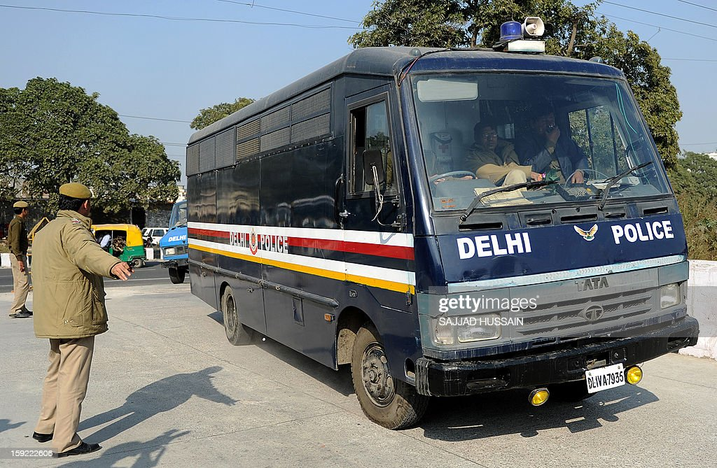 Indian police personnel guide a prisoner transport vehicle at an entrance to the Saket District Court in New Delhi on January 10, 2013 prior to the hearing of a gang rape and murder case. A defence lawyer accused Indian police Thursday of beating confessions out of five men charged with murdering and gang-raping a student in New Delhi, as they were due to appear in court again.