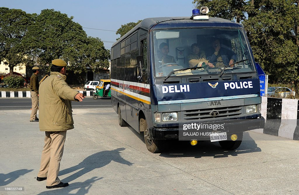 Indian police personnel guide a prisoner transport vehicle at an entrance to the Saket District Court in New Delhi on January 10, 2013 at the hearing of a gang rape and murder case. A defence lawyer accused Indian police Thursday of beating confessions out of five men charged with murdering and gang-raping a student in New Delhi, as they were due to appear in court again.