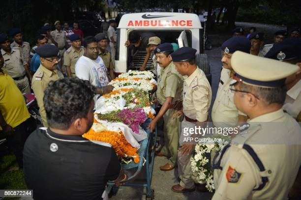 Indian police personnel pay homage to slain police officer Amitava Malik who was killed during a gunfight between West Bengal police and suspected...
