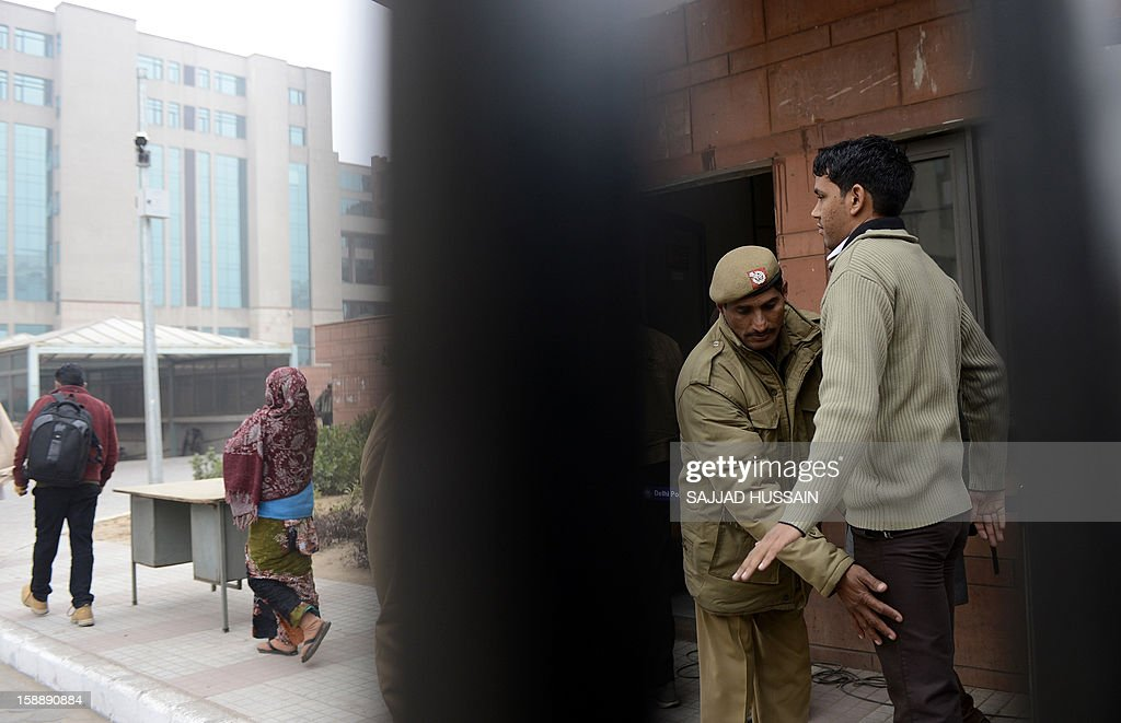 Indian police personnel search pedestrians as they enter the district court Saket in New Delhi on January 3, 2013. A gang of men accused of repeatedly raping a 23-year-old student on a moving bus in New Delhi in a deadly crime that repulsed the nation are to appear in court for the first time. Police are to formally charge five suspects with rape, kidnapping and murder after the woman died at the weekend from the horrific injuries inflicted on her during an ordeal that has galvanised disgust over rising sex crimes in India. AFP PHOTO/Sajjad HUSSAIN