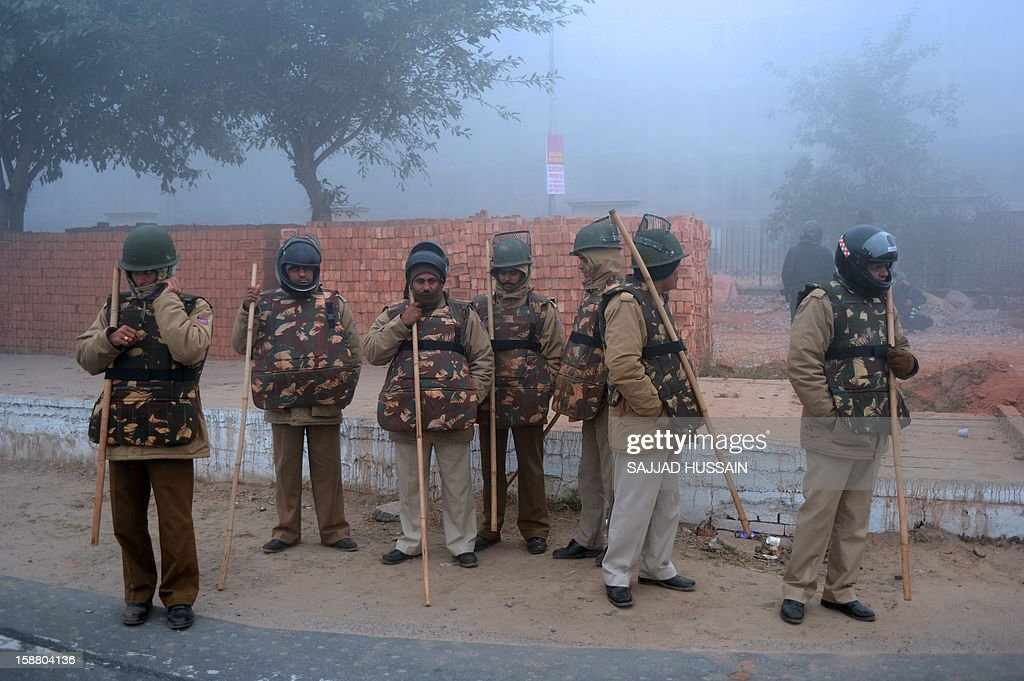 Indian police personnel stand alert outside a cremation ground in New Delhi on December 30, 2012, ahead of a cremation ceremony for a gangrape victim. The victim of a gang-rape and murder which triggered an outpouring of grief and anger across India was cremated at a private ceremony, hours after her body was flown home from Singapore. The unidentified 23-year-old, the focus of nationwide protests since she was brutally attacked on a bus in New Delhi two weeks ago, was cremated away from the public glare at the request of her traumatised parents.