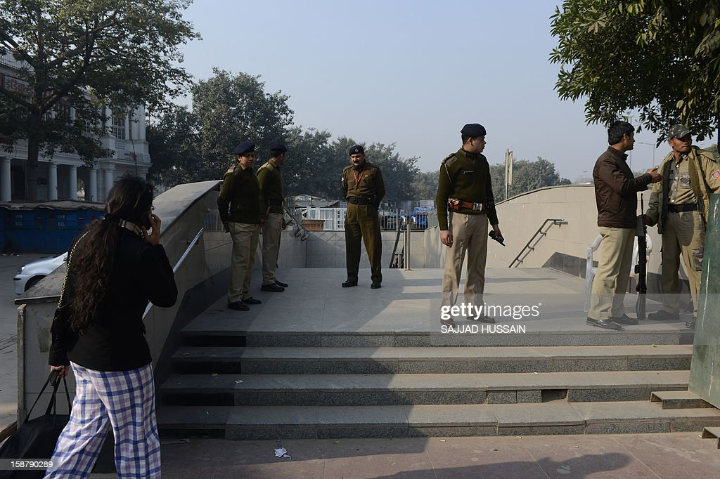 Indian police personnel stand alert outside the entrance to a closed metro station in New Delhi on December 29, 2012, as Indian leaders appealled for calm fearing fresh outbursts of protests after the death of a gang-rape victim. New Delhi's top police officer and chief minister have urged people to mourn the death of a gang-rape victim in a peaceful manner as large parts of the city-centre were sealed off. The calls for calm came after an Indian woman who was gang-raped on a New Delhi bus died in a Singapore hospital after suffering severe organ failure.