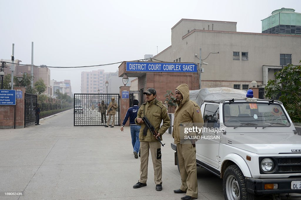 Indian police personnel stand guard at an entrance to Saket District Court in New Delhi on January 7, 2013. Five men charged with the brutal gang-rape and murder of a student in New Delhi will appear in court for the first time after police said they had forensic evidence to link them to the killing.