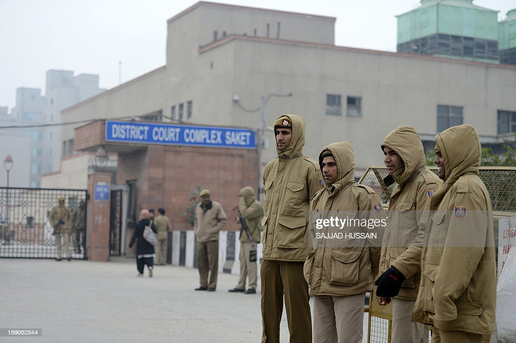 Indian police personnel stand guard at an entrance to Saket District Court in New Delhi on January 7, 2013. Five men charged with the brutal gang-rape and murder of a student in New Delhi will appear in court for the first time after police said they had forensic evidence to link them to the killing. AFP PHOTO/SAJJAD HUSSAIN