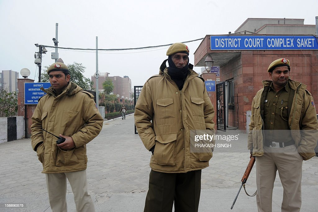 Indian police personnel stand guard outside the district court Saket in New Delhi on January 3, 2013. A gang of men accused of repeatedly raping a 23-year-old student on a moving bus in New Delhi in a deadly crime that repulsed the nation are to appear in court for the first time. Police are to formally charge five suspects with rape, kidnapping and murder after the woman died at the weekend from the horrific injuries inflicted on her during an ordeal that has galvanised disgust over rising sex crimes in India. AFP PHOTO/ Prakash SINGH