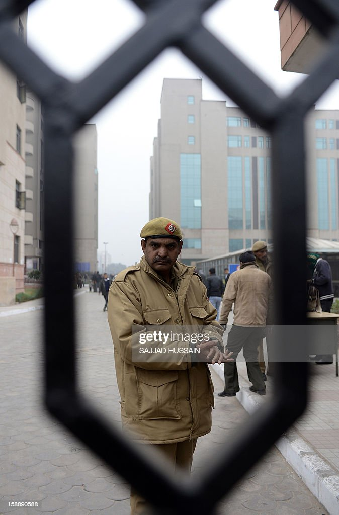 Indian police personnel stand guard outside the district court Saket in New Delhi on January 3, 2013. A gang of men accused of repeatedly raping a 23-year-old student on a moving bus in New Delhi in a deadly crime that repulsed the nation are to appear in court for the first time. Police are to formally charge five suspects with rape, kidnapping and murder after the woman died at the weekend from the horrific injuries inflicted on her during an ordeal that has galvanised disgust over rising sex crimes in India.