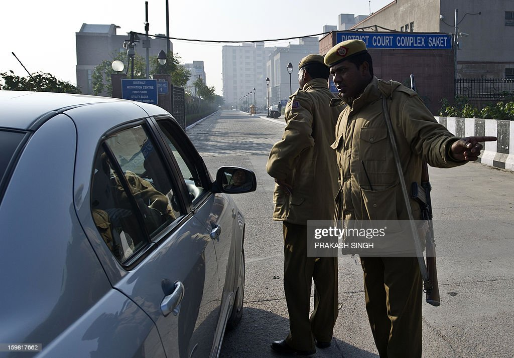 Indian police personnel stand guard outside the district court Saket in New Delhi on January 21, 2013. The father of a student who died after being gang-raped on a bus in New Delhi called for swift justice and for her attackers to be hanged as five men accused of her murder prepared to go on trial. A defence lawyer tried to persuade India's top court that the trial should be shifted out of the capital, but the father of the 23-year-old victim said her family would only rest once a fast-track court had handed down its verdict. AFP PHOTO/ Prakash SINGH