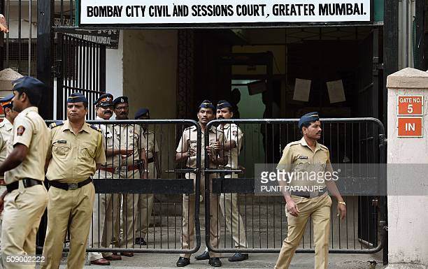 Indian police personnel stand guard outside the sessions court in Mumbai on February 8 2016 An American who helped plot the Mumbai attacks told a...