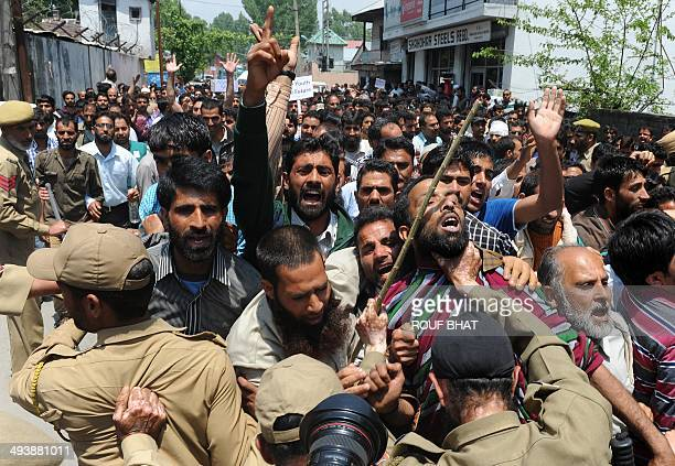 Indian police push back Kashmiri state government employees during a protest march in Srinagar on May 262014 Indian police detained dozens of...