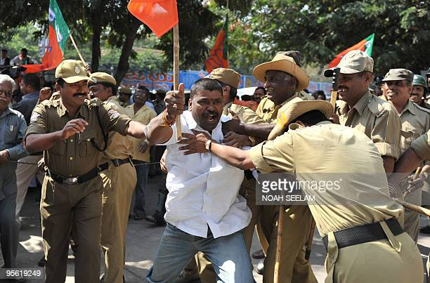 Indian police push back protestors from the Bharatiya Janata Party as they try to enter the Bus Bhavan during their protest against busfare hikes in...