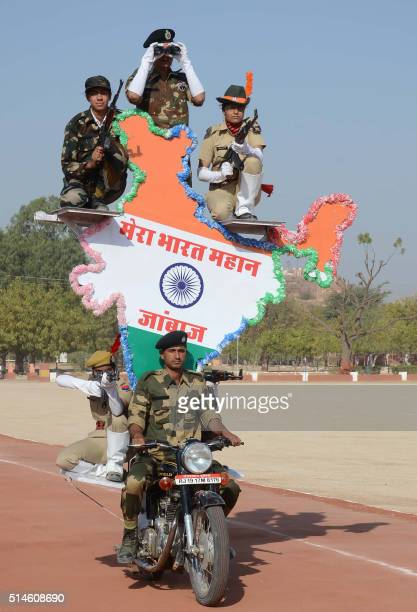 Indian police recruits perform a routine on a motorcycle as they take part in a passing out parade at The Rajasthan Police Training Centre in Jodhpur...