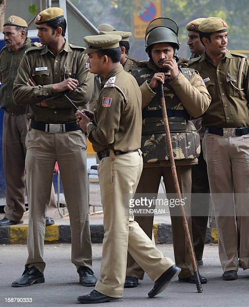 Indian police stand alert on a street in New Delhi on December 29 as Indian leaders appealled for calm fearing fresh outbursts of protests after the...
