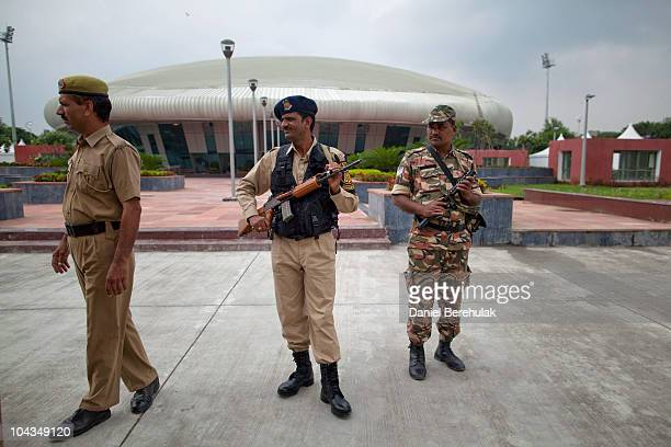 Indian police stand guard at the site of the weightlifting venue for the approaching 19th Commonwealth Games 2010 Delhi at Jawaharlal Nehru Stadium...