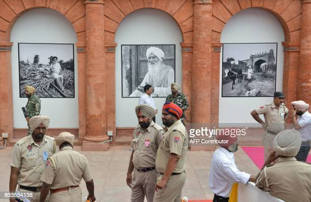 Indian police stand guard during the reinauguration ceremony of the Partition Museum in Amritsar on August 17 2017 This month marks 70 years since...