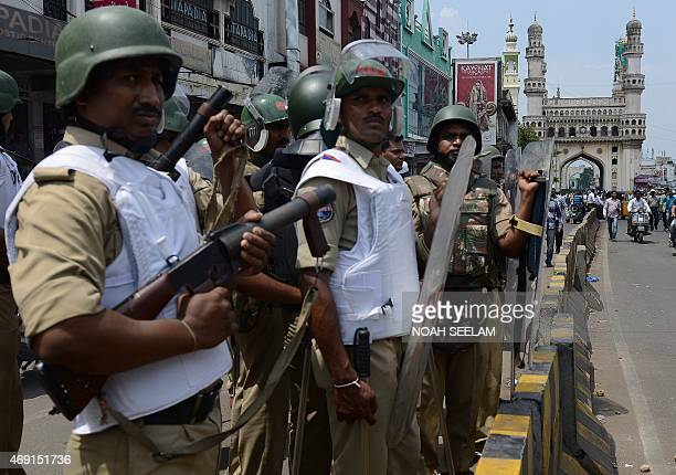 Indian police stand guard outside Mecca Masjid during Friday prayers in Hyderabad on April 10 2015 Security has been increased in the city after the...