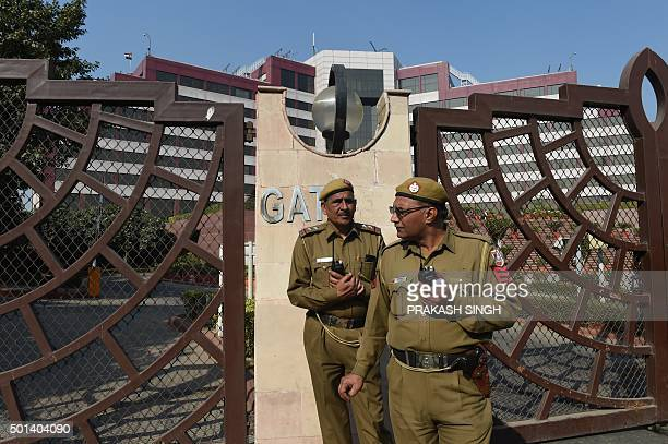 Indian police stand guard outside the Delhi Secretariat in New Delhi on December 15 2015 Delhi's Chief Minister Arvind Kejriwal accused Indian Prime...