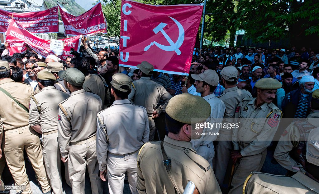 Indian police stop Kashmiri government contractual workers and daily wagers from various labour groups during a protest marking the International Labor Day Labor Day on May 01, 2016 in Srinagar, the summer capital of Indian administered Kashmir, India. Hundreds of Kashmiri government contractual workers and daily wagers from various labour groups took part in a rally on International Labor Day and staged a demonstration to draw attention to their hardships caused by the delay in fulfilling their demands. The demonstrators demanded an increase in their salary. The protest march was organized by Communist Party of India.