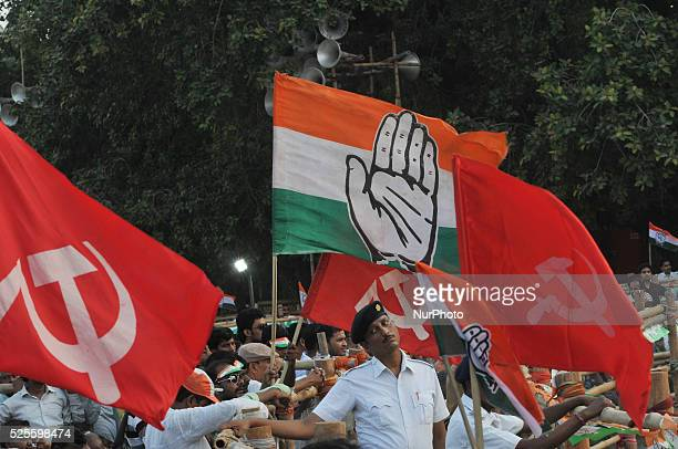Indian police strand on duty Supporters hold Congress and CPI Party Flag during Congress Vice President Rahul Gandhi and CPI veteran and former Chief...