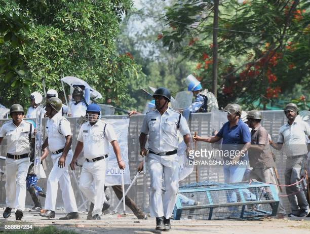 Indian police take part in a batoncharge as they disperse Leftist demonstrators during a march towards the state secretariat in Kolkata on May 22...