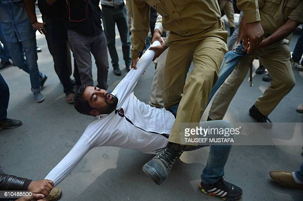 TOPSHOT Indian police try to detain supporters of Jammu and Kashmir lawmaker Sheikh Engineer during a march towards the United Nations Military...